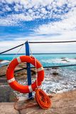 Lifebuoy at the beach. Turquoise sea, blue sky stock image