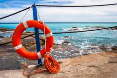 Lifebuoy at the beach. Turquoise sea, blue sky royalty free stock images
