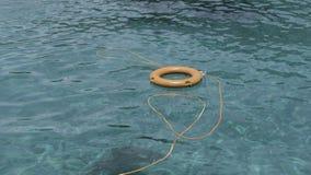 Lifebuoy in a blue sea. Andaman sea Royalty Free Stock Photos