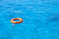 Lifebuoy in the blue sea. Orange Lifebuoy in the blue sea Royalty Free Stock Photos