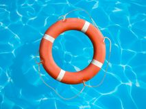 Lifebuoy on blue water surface concept Stock Photo