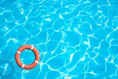 Lifebuoy on blue water surface concept Stock Photography