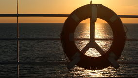 Lifebuoy on a boat crossing the sea at sunset stock video footage