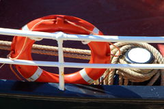 Lifebuoy and boat`s rail Stock Images