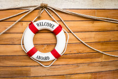 Lifebuoy on a boat. Welcome aboard Lifebuoy on a boat Royalty Free Stock Image