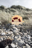 Lifebuoy buried in the rocks Royalty Free Stock Photo