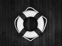 Lifebuoy. Classic lifebuoy on a wooden planks. Monochrome stock images