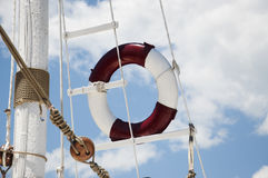 Lifebuoy on a close-up mast. Lifebuoy in a mast against a blue sky with clouds a close-up Royalty Free Stock Images