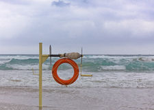 Lifebuoy on the coast Stock Photography