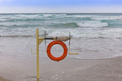 Lifebuoy on the coast Stock Images