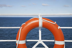 Lifebuoy and cruise railing deck Royalty Free Stock Images