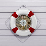 Lifebuoy 3d render on a white wooden background Stock Image