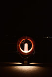 Lifebuoy with dim light near a beach Royalty Free Stock Image