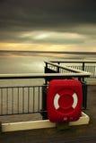 Lifebuoy en el embarcadero Foto de archivo libre de regalías