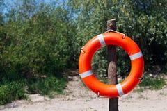Lifebuoy en la playa Imagen de archivo libre de regalías