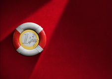 Lifebuoy with Euro Coin Royalty Free Stock Images