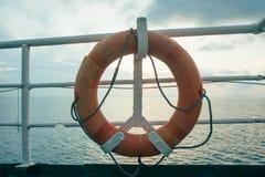 Lifebuoy ferry boat, ferry, travel, sea, lifebuoy, water, vacation, ship, life, ring. Lifebuoy ferry railing, emergency, equipment, circle, harbor orange Stock Images
