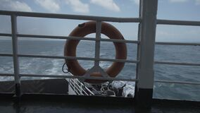 Lifebuoy ferry boat, ferry, travel, sea, lifebuoy, water, vacation, ship, life, ring. Lifebuoy ferry railing, emergency, equipment, circle, harbor orange stock video footage
