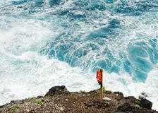 Lifebuoy in front of wild surf royalty free stock image