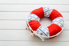 Lifebuoy handmade pillow with copyspace Stock Photos