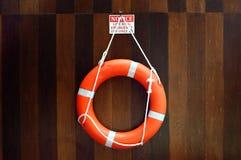 Lifebuoy hang on a  wall Royalty Free Stock Photography