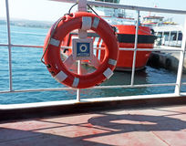 Lifebuoy hanged on the side bars of the boat Royalty Free Stock Image