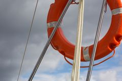 Lifebuoy hanging on back part of yacht Stock Image