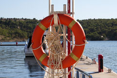 Lifebuoy. Hanging on the pier Royalty Free Stock Photos