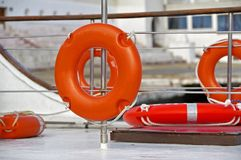 Lifebuoy hanging on the powerboat. Orange lifebuoy attached to board the ship Royalty Free Stock Images