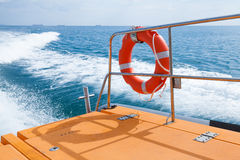Lifebuoy hanging on railings of fast rescue boat Royalty Free Stock Image