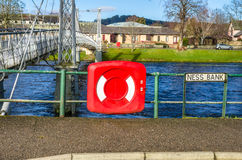 Lifebuoy hanging on railings Stock Image