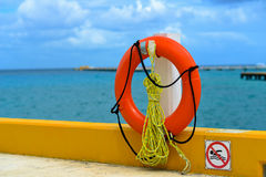 Lifebuoy hanging on a ship Stock Images