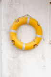 Lifebuoy Hanging on the Wall Stock Image