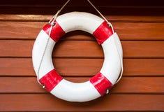 Lifebuoy. Hanging on wood wall Stock Photo