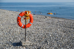 Lifebuoy hangs on the beach for the safety of people on swimming on sea Stock Photography