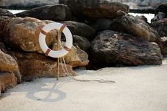 Lifebuoy hangs on a stick on the beach Stock Photography