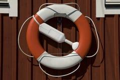 Lifebuoy haning en una casa Imagenes de archivo