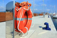 Lifebuoy in harbor. Marine security concept, red lifebuoy in harbor Royalty Free Stock Image
