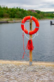 Lifebuoy on the harbor Royalty Free Stock Images