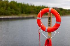 Lifebuoy on the harbor Royalty Free Stock Image