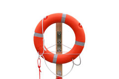 Lifebuoy on the harbor, white background. Orange lifebuoy on the harbor, white background Stock Photography