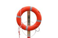 Lifebuoy on the harbor, white background. Stock Photography