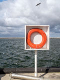 Lifebuoy at the harbour. Lifebuoy attached to the stand at the harbour Stock Image