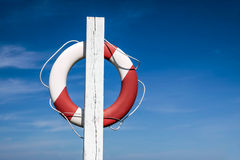 Lifebuoy In Front Of Blue Sky Stock Photography