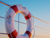 Lifebuoy In Front Of Railing Fence On The Deck Royalty Free Stock Image