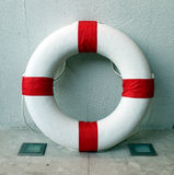 Lifebuoy inside the wall Royalty Free Stock Photos