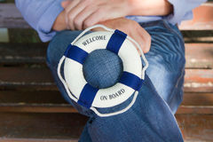 Lifebuoy or life-belt; concept for cruising, sailing or teamwork Stock Photo