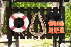 Lifebuoy,life jacket and rope. In island Stock Photos