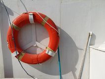 Lifebuoy or life preserver hanging on a boat Stock Photo