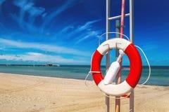 Lifebuoy, Life Preserver on Sandy Beach Royalty Free Stock Images